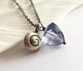 Silver nautilus and quartz triangle long necklace